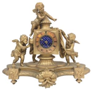 Pendule bronze sujet lanterne magique